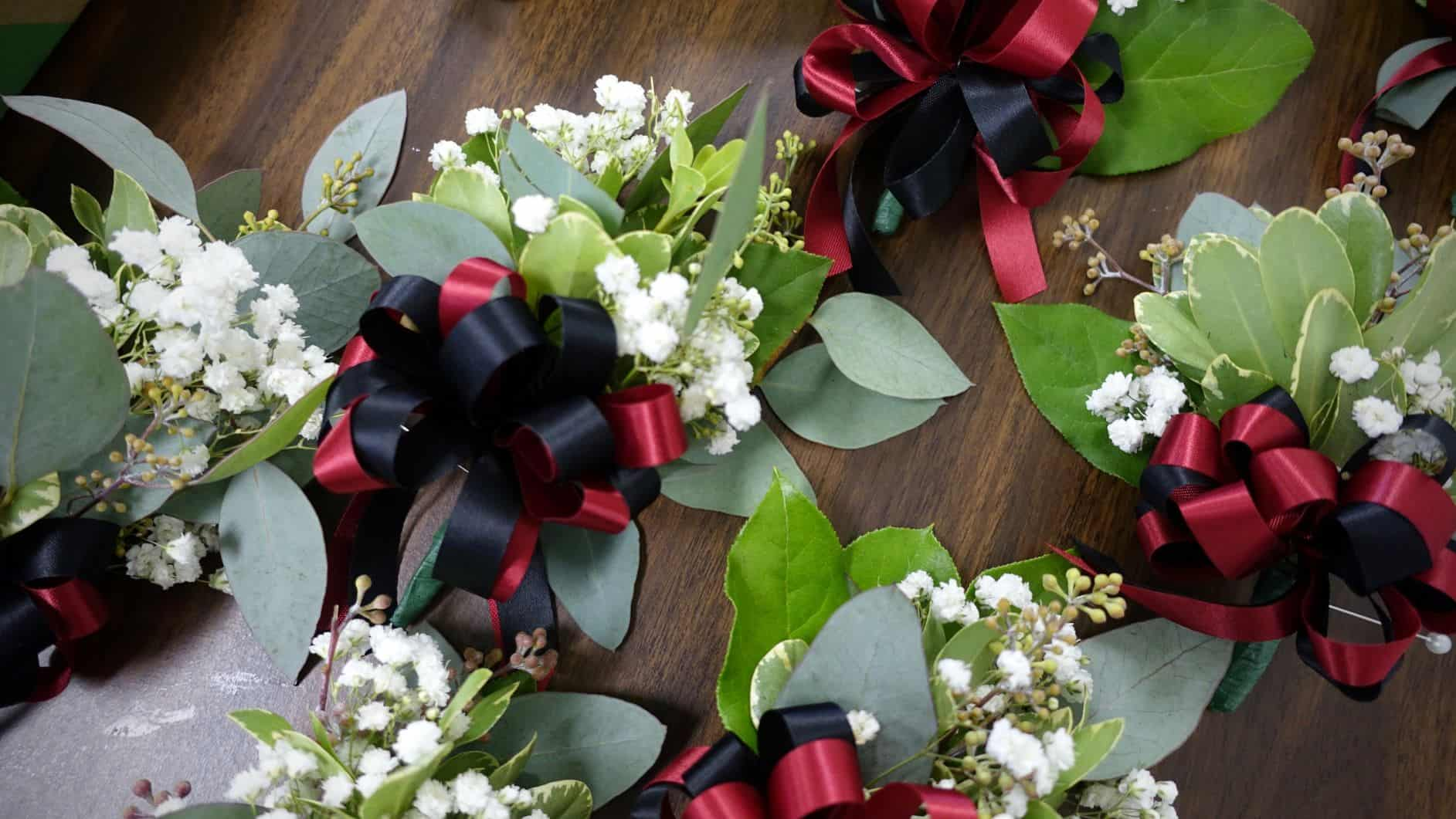 Corsages laid outon a table for the Elders